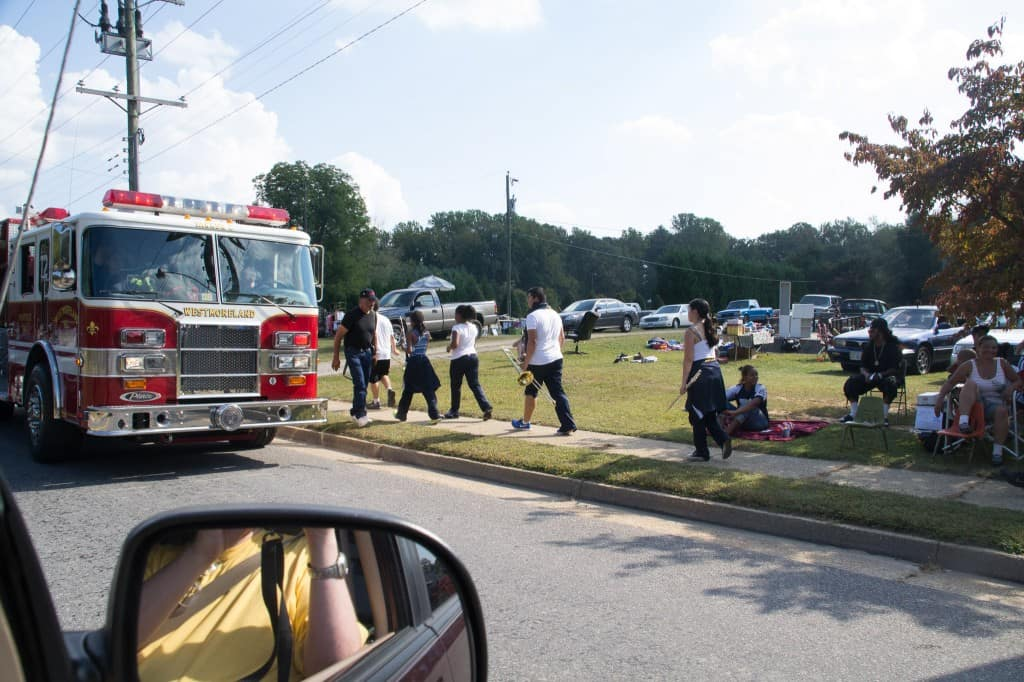 Firetrucks, and spectators along the road.