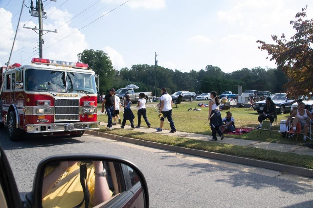 Firetrucks, and spectators along the road.
