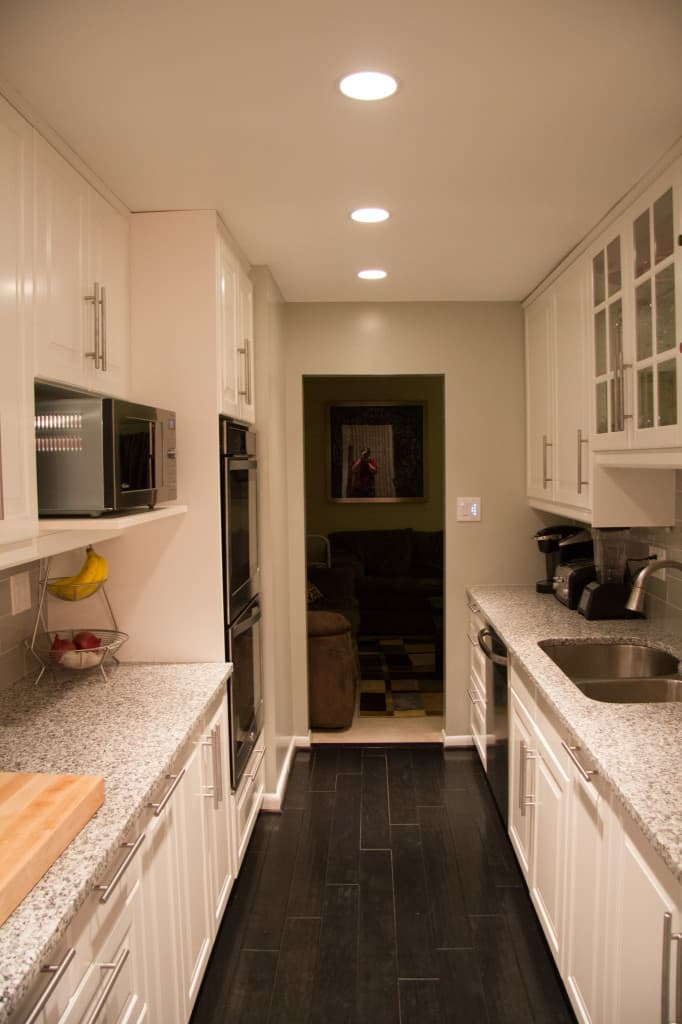 Closer view of the kitchen area, including the double oven and microwave